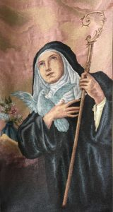image of St. Scholastica from monastery chapel tapestry