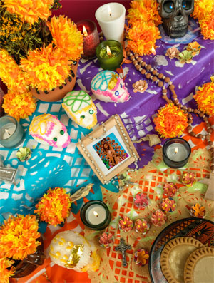 flowers, candles, photos and other decorations for Dia de los Muertos